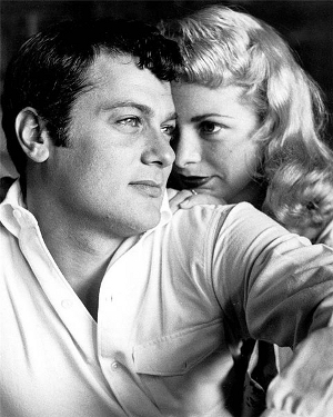 Circa-1960 movie studio publicity photo of Tony Curtis with then-wife Janet Leigh.