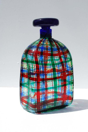 Christian Dior incorporated a Scottish tartan design into this blow glass decanter made by Barovier & Toso, Italy, in 1969. The decanter is 9 inches high, 5 inches wide, 3 inches deep and has a $5,000-$7,000 estimate. Image courtesy of Palm Beach Modern Auctions.