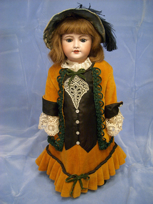 French 21-inch doll by Unis, jointed, with composition body and bisque head. Image courtesy of Browne Auction Specialists.