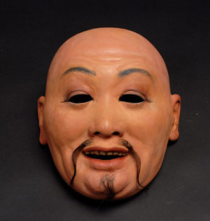 Kolma's Chinese mask, robe, costume and accessories comprise lot 257, which has a $4,000-$6,000 estimate. Michael Bornstein donned the mask and accompanying full-length robe, pants, tasseled hat and slippers, transforming him into his performing persona, the Chinese magician Kolma. Image courtesy of Potter & Potter Auctions.