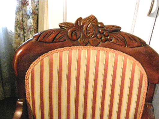 The carving on this 1950s reproduction Rococo Revival chair is mostly spindle-carved and touched up by hand. It would be a stretch to call it hand-carved. Fred Taylor photo.