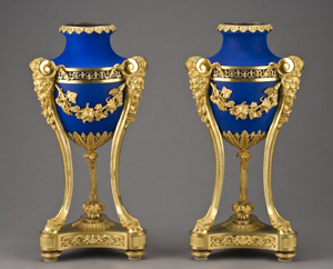 These signed Henry Dasson urns with matte blue porcelain bodies in fine gilt bronze are dated 1884. The pair has an estimate of $15,000-$25,000. Image courtesy of Dallas Auction Gallery.