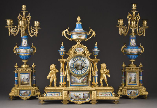 Three-piece Sevres-style gilt bronze clock garniture set, including a porcelain dial mantel clock in a bronze case, est. $16,000-$24,000. Image courtesy of Dallas Auction Gallery.