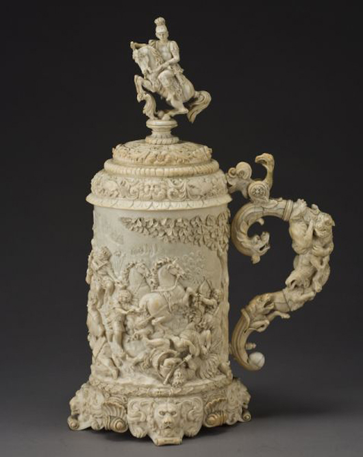 Large German ivory tankard and cover depicting the Battle of Guagemela, carved in the 17th century Ausberg style, 18 1/2 inches high, 10 inches wide, circa 19th century, est. $30,000-$50,000. Image courtesy of Dallas Auction Gallery.