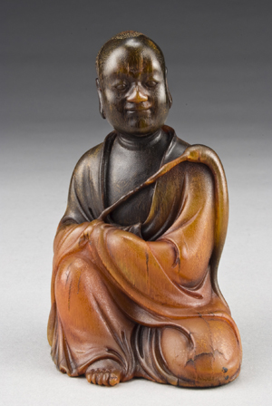 Chinese carved rhino horn Luohan holding a fuchen, 4 3/4 inches high, circa 19th century, price realized: $85,750. Image courtesy of Dallas Auction Gallery.