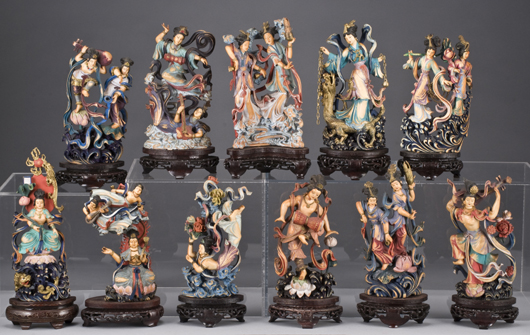 Eleven carved polychrome ivory Asparas (nymphs) depicting female spirits dancing and playing musical instruments, largest 9 1/2 inches high, circa 20th century, price realized: $22,050. Image courtesy of Dallas Auction Gallery.