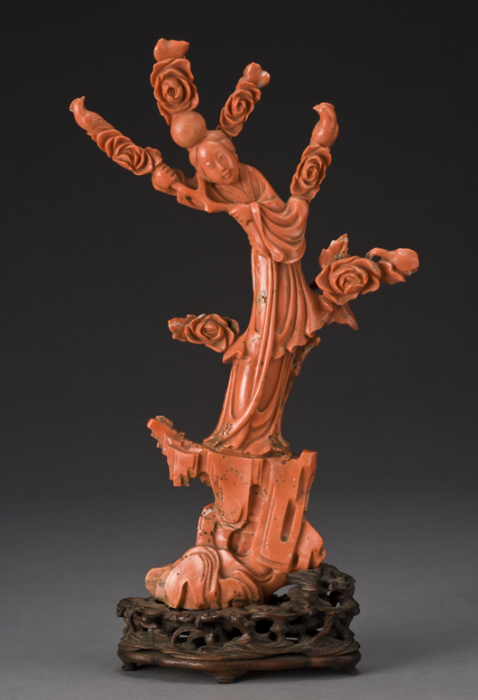Chinese Qing carved red coral sculpture depicting a beauty holding flowers, coral, with stand, 936.8 grams, 14 inches high x 8 inches wide x 2 1/2 inches deep, circa late 19th century, price realized: $20,825. Image courtesy of Dallas Auction Gallery.