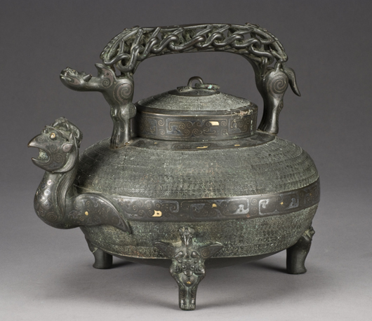 Gold and silver inlaid Ming bronze tripod ewer raised on three bird supports, 9 inches high x 11 inches wide, circa 1368-1644, price realized: $20,825. Image courtesy of Dallas Auction Gallery.