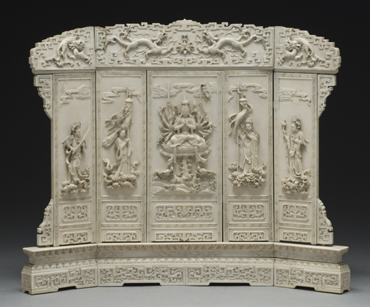 Chinese Qing carved ivory table screen, carved to depict a Buddha attended by four Bodhisattvas, 13 inches high x 16 inches wide, circa 19th century, price realized: $42,875. Image courtesy of Dallas Auction Gallery.