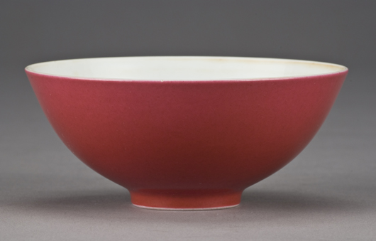 Chinese Yanzhi red porcelain bowl, six character mark for 'Great Qing Yongzhou Production,' 2 inches high x 4 3/4 inches wide, circa 18th-19th century, price realized: $24,500. Image courtesy of Dallas Auction Gallery.