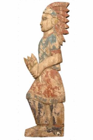 This painted cutout cigar-store Indian was made about 1900, probably in the Midwest. The back is a flat board. The front has some shallow carving to indicate the figure's limbs and facial features. Copake Auction in Copake, N.Y., sold it for $575 in March 2010