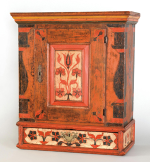 Berks County, Pa., hanging cupboard, circa 1780, 27 1/4 inches high x 21 1/2 inches wide. Est. $50,000-$80,000. Image courtesy of Pook & Pook Inc.