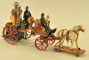 This early 20th-century Marklin steam-powered, horse-drawn fire pumper features a hand-painted body with copper-finished upright boiler and two finely painted figures. Thirteen inches from hitch to platform, it is expected to make $18,000-$22,000. Bertoia Auctions image.
