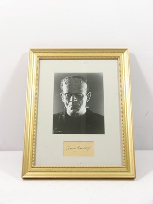 'Frankenstein' (1931) – From Chris Kattan's personal collection, this is a photo of The Monster in 'Frankenstein,' with the autograph of Boris Karloff (The Monster) on a index card, framed and matted, (approx. 18 1/2 inches x 14 3/4 inches). Estimate: $3,000-$6,000. Photo copyright Premiere Props.