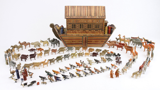 Circa-1870 Erzgebirge (Germany) ark with painted-straw marquetry designs, more than 200 passengers including six people and 61 pairs of animals, 23 pairs of birds; 22 inches long, estimate $4,000-$6,000. Noel Barrett image.