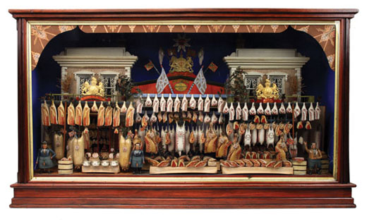 Extraordinary late-19th-century English butcher shop comprised of a pair of two-story Georgian buildings, outdoor stands manned by three stout butchers and stocked with carved and painted replicas of various meats, poultry and sausages, estimate $30,000-$50,000. Noel Barrett image.