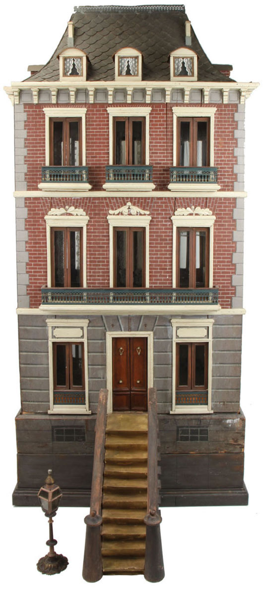 """Spanish Second Empire doll's house with 1888 date and maker's name """"Pintor Rafael"""" on back of façade. Magnificently restored, pictured in 1980 book Dollhouses Past and Present. Three-story townhouse features quoining and mansard roof simulating slate, estimate $10,000-$15,000. Noel Barrett image."""