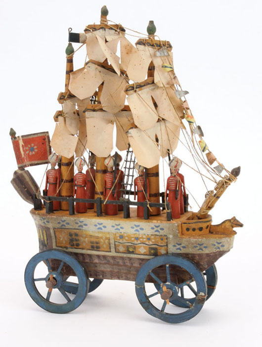 Early to mid-19th-century Erzgebirge (Germany) ship with paper sails, pennants and flag; carved-wood horse figurehead, 12 painted-wood sailors, 7¾ inches long, estimate $8,000-$10,000. Noel Barrett image.