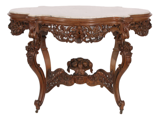 J. & J.W. Meeks rosewood marble-top center table, heavily carved and extremely ornate. Image courtesy of Fontaine's Auction Gallery.