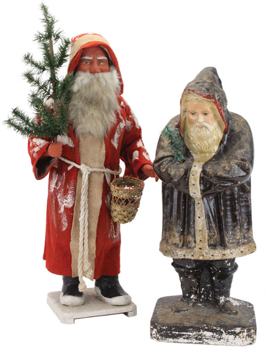 (Left) Exceptional German Santa candy container with finely painted face, 28 inches tall, estimate $3,000-$4,000; late-19th-century chalkware belsnickle, 23 inches tall, pictured in Schiffer's 1995 book Christmas Ornaments, estimate $15,000-$20,000. Noel Barrett image.