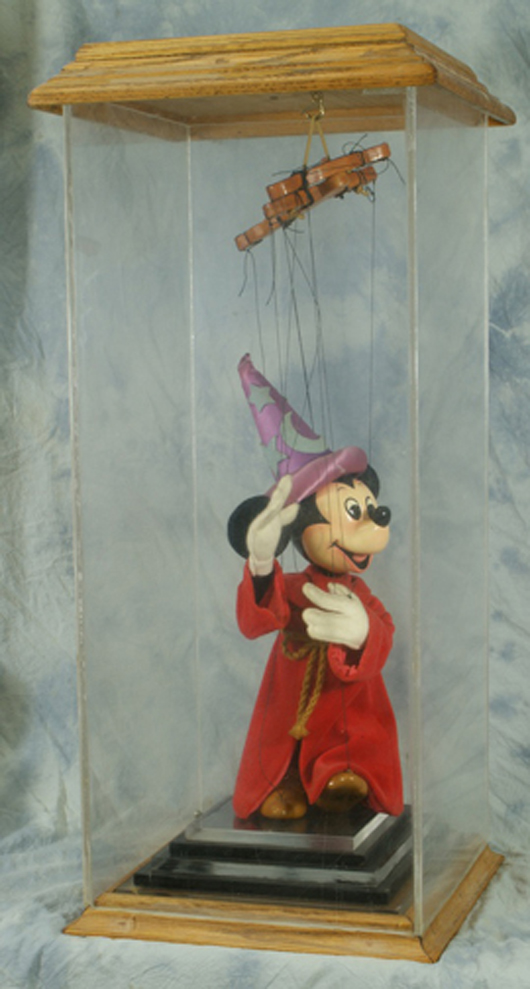 Mickey Mouse marionette designed by artist Bob Baker, 29¾ inches tall, in oak and Lucite case, limited edition 7/25, original cost $1,700. William H. Bunch Auctions image.