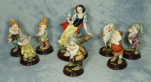 """Armani 8-piece porcelain set """"Snow White and the Seven Dwarfs,"""" Snow White figure is 9¾ inches tall, original cost $3,000. William H. Bunch Auctions image."""