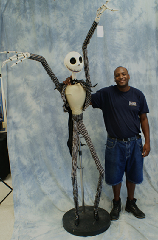 Disney 8-foot-tall articulated figure of Jack Skellington, from The Nightmare Before Christmas, shown for scale alongside Bunch Auctions employee Tony Fountain, who is 6ft. 2 in. tall. William H. Bunch Auctions image.