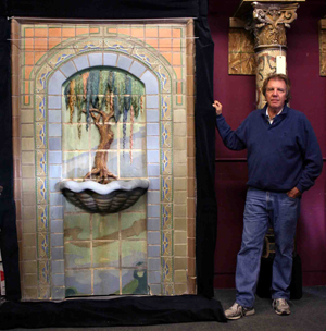 Wooden Nickel Antiques owner Michael Williams stands beside the recovered fountain in the Wooden Nickel showroom. Image courtesy of Wooden Nickel Antiques.