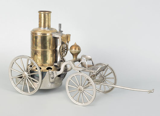 Brass and steel model of a steam fire engine, circa 1900, inscribed Weedens Upright Engine No 2 Patented May 19, 1885, 10 inches high x 18 inches wide. Image courtesy of Pook & Pook Inc.