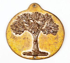 Cast-iron green tree fire mark, circa 1827, for the Mutual Assurance Co., Philadelphia, 8 1/4 inches high x 8 1/2 inches wide. Image courtesy of Pook & Pook Inc.