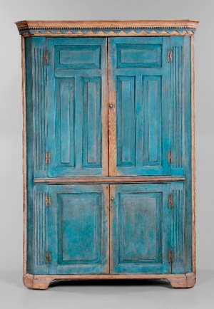 Among the 12 Georgia painted furniture lots consigned by Mr. and Mrs. Levon Register of Franklin Springs, Ga., this late 18th- or early 19th-century corner cupboard has the highest estimate: $12,000 to $18,000. It measures 85 1/4 inches x 59 4/4 inches x 30 1/2 inches. The cupboard has its original backboard with undisturbed rosehead nails. Three fixed shelves are behind the two triple-paneled doors. Image courtesy of Brunk Auctions.