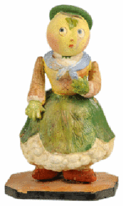 This old papier-mache candy container seems to promote healthy eating with her cauliflower body, radish arms and carrot feet. But it must have pleased children when they found candy inside. Morphy Auctions of Denver, Pa., sold the 9 1/2-inch container for $4,312.