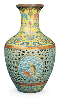 An extremely rare and important 18th-century Qianlong reticulated porcelain ovoid vase decorated with famille rose and famille jaune enamels, that set a new world record for a Chinese work of art when it sold at Bainbridge's London auction rooms for 51.6 million pounds ($83.2 million), including buyer's premium. Image courtesy Bainbridge's.