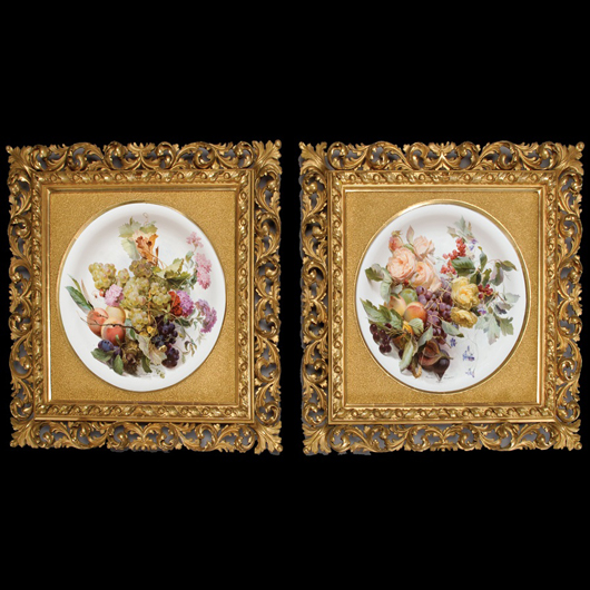 Pair of Meissen porcelain botanical plaques mounted in giltwood frames.
