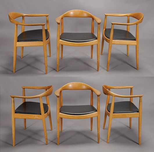 Set of six Hans Wegner walnut chairs branded 'Johannes Hansen Copenhagen Denmark.' Estimate: $3,000-$5,000. Image courtesy of Michaan's Auctions.