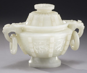 Carved with dragon handles with two free rings, this 5 1/2-inch jade lidded censer sold for $80,000. Image courtesy of Dallas Auction Gallery.