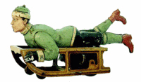 This lithographed tin boy-on-sled toy is 7 inches long. It sold at RSL Auction Co. for $334. Image courtesy RSL Auction Co.