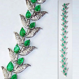 Emeralds and diamonds form the buds and leaves respectively on this 18K white gold bracelet. Estimate: $8,075-$9,100. Image courtesy of Auktionshaus Gut Bernstorf.