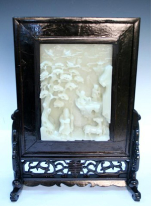 Chinese carved white jade screen, 19th century, unmarked, 18 1/4 inches high x 13 3/8 inches wide x 5 1/2 inches deep. Estimate: $13,000-$15,000. Image courtesy of Auctions by Showplace Antique & Design Center.