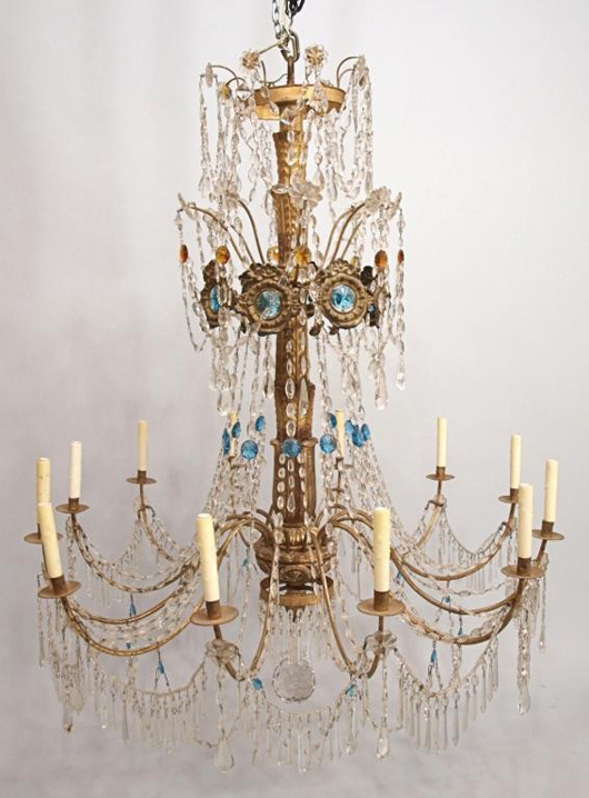 Italian gilt metal and crystal chandelier, 19th century, 12 scrolled branches set with 12 lights and a large faceted crystal ball hanging from the center, 58 inches high. Estimate: $7,000-$12,000. Image courtesy of Austin Auction Gallery.