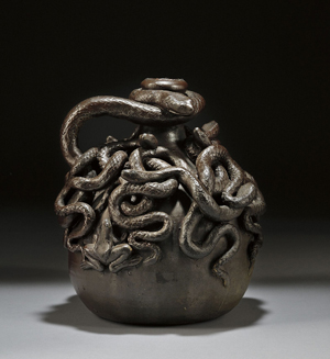 Made by Anna Pottery in Illinois, this 9-inch-high stoneware snake jug is inscribed 'Centennial 1876 Kirkpatrick Anna Pottery Anna, Ill.' It carries a $20,000-$30,000 estimate. Image courtesy of Skinner Inc.