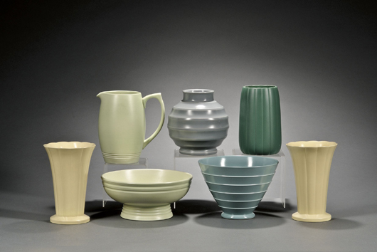 Three Wedgwood Keith Murray design matte straw slip glazed items, circa 1935, two fluted vases, and a water pitcher. Estimate:  $400-$600. Image courtesy of Skinner Inc.