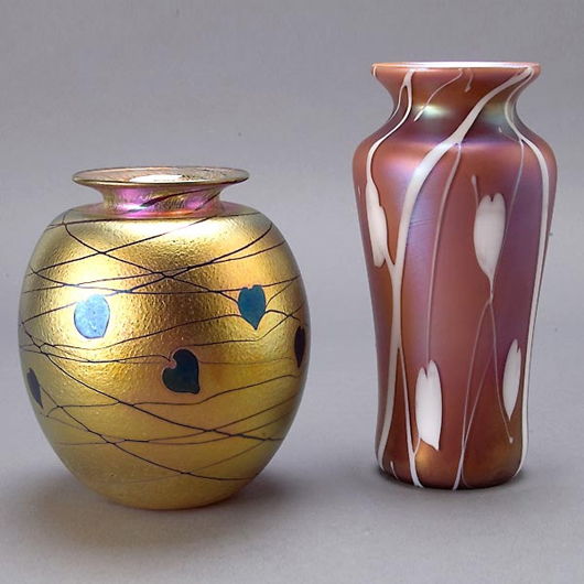 Two Donald Carlson art glass vases, iridescent glass with leaf motif, signed and numbered on base, heights 5 3/4 inches and 7 1/2 inches. Estimate: $400-$600. Image courtesy of Michaan's Auctions.
