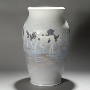 A partial sticker from the 1926 Philadelphia World's Fair is on this 24 1/2-inch-tall Royal Copenhagen vase decorated with a cow motif. It is expected to bring $1,200-$1,500. Image courtesy of Michaan's Auctions.