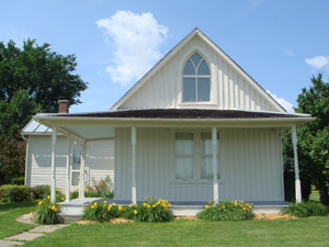 The house depicted in Grant Wood's masterpiece 'American Gothic' is in Eldon, Iowa. Image courtesy of Wikimedia Commons.