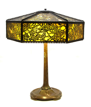 Tiffany Studios paneled Favrile glass and bronze table lamp, Grapevine pattern, the hexagonal shade stamped Tiffany Studios New York, the base stamped Tiffany Studios New York 531, width of shade 16 inches, height overall 21 inches, estimate: $15,000-$20,000. Image courtesy of Leslie Hindman Auctioneers.