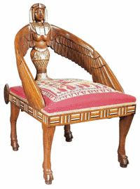 This chair, carved and inlaid to resemble Egyptian artifacts, was made in the early 20th century, although the design dates from the early 19th century. It brought $3,540 last year at a Neal Auction in New Orleans. Beautiful but uncomfortable.