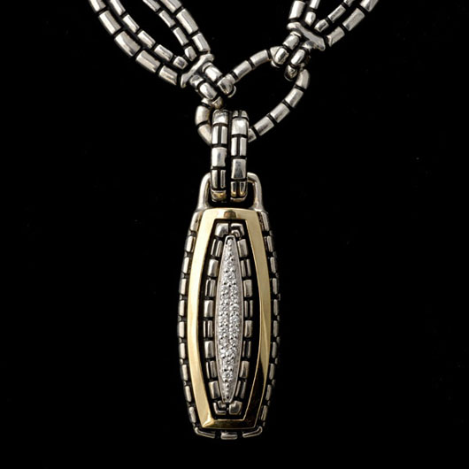 John Atencio diamond, 14K yellow gold, sterling silver pendant necklace. Estimate: $600-$900. Image courtesy of Michaan's Auctions.