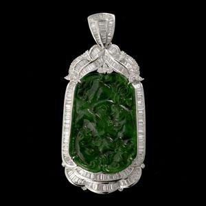 Lot 238: jade, diamond, 18K while gold pendant enhancer. Estimate: $15,000-$25,000. Image courtesy of Michaan's Auctions.