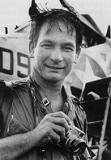 Henri Huet, famed photographer of the Vietnam-War-era. Photographer who took this picture is unknown. Fair use of assumed-copyrighted, historically significant and unique image sourced from The Digital Journalist and used expressly to illustrate the subject of the article it accompanies. No alternative, public domain or copyright-free replacement image is available. Image is for informational and educational purposes only, directly pertaining to article about exhibit profiling Huet's work as a Vietnam-War-era photographer. Image must not be copied or linked to.